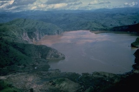 Lake Nyos as it appeared shortly after the disaster. The water is clouded with debris. Source: USGS
