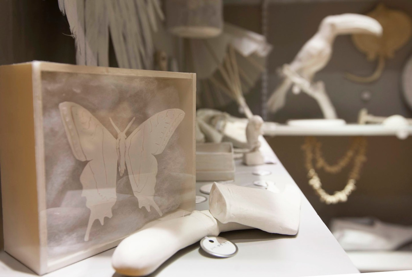 Replicas of lost specimens and artifacts represented in ghostly white.