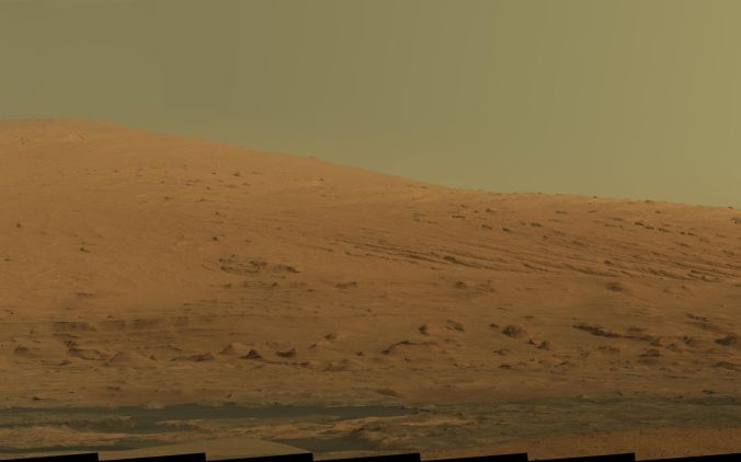 This mosaic of images from the Mastcam onboard NASA's Mars rover Curiosity shows Mount Sharp in raw color. Raw color shows the scene's colors as they would look in a typical smart-phone camera photo, before any adjustment. Image credit: NASA/JPL-Caltech/MSSS