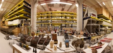 Anthropological collections on display in Pod 4 (designed to house oversized objects) at the Smithsonian Institution's Museum Support Center (MSC), located in Suitland, Maryland. Anthropology collections staff present. Panoramic image #7 of 7 at 26mm focal length.