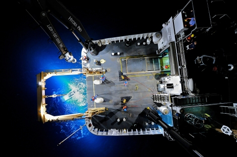 A unique down-looking view of a ROV recovery at night. Carl VerPlanck captured this image by strapping his camera to a crane and extending it 30-ft above the deck.   Photo: NOAA
